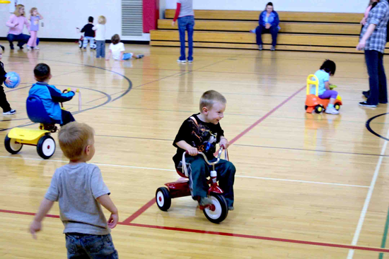 A group of children playing in a gymnasium